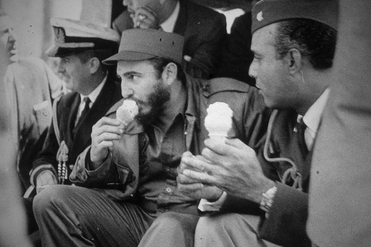 Cuban president Fidel Castro eats an ice cream cone as he rides in the Bronx Zoo train, New York City, April 2. 1959. (Photo by Meyer Liebowitz/Getty Images)